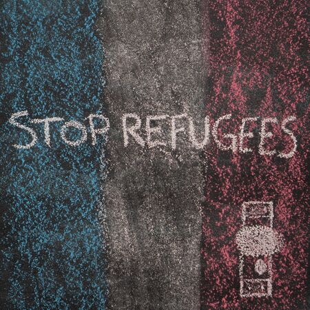 French flag with door drawn with chalk on blackboard. Next to the door handle text Stop Refugees