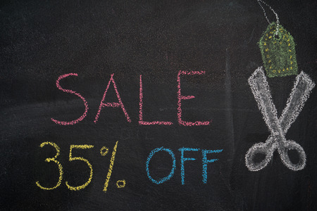 thirty percent off: Sale 35% off. Sale and discount price sign with scissors cutting price tag drawn with chalk on blackboard