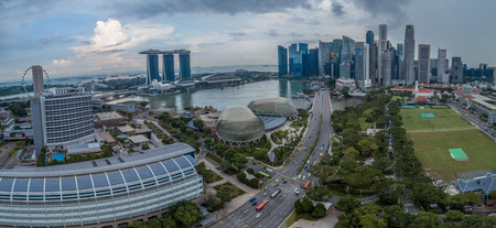 Aerial view panorama of Singapore skyscrapers with city skyline during cloudy summer day
