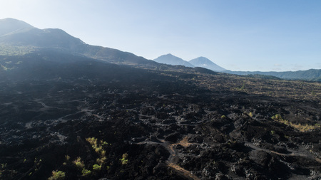 Aerial drone view of volcanic rocky landscape in Bali, Indonesia