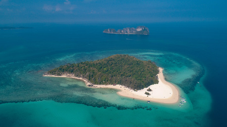 Aerial drone view of beautiful tropical Bamboo Island white beach with boats in Thailand