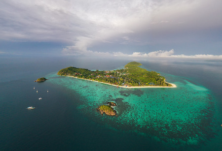 Aerial drone view of beautiful tropical Koh Lipe island during sunny summer day, Thailand