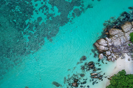 Aerial drone view of beautiful tropical beach with white sand and crystal clear lagoon sea water