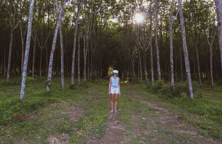 Woman in the forest uses VR virtual reality glasses and is amazed by nature