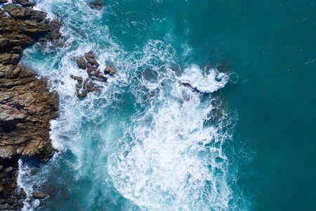 Aerial drone view of ocean's beautiful waves crashing on the rocky island coast Reklamní fotografie
