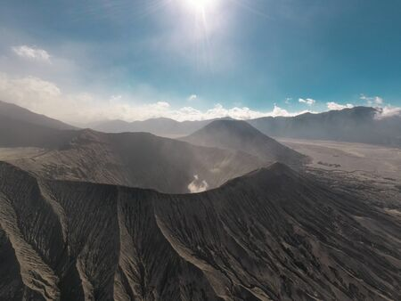 Cinematic shot aerial drone view of Mount Bromo crater edge in East Java, Indonesia
