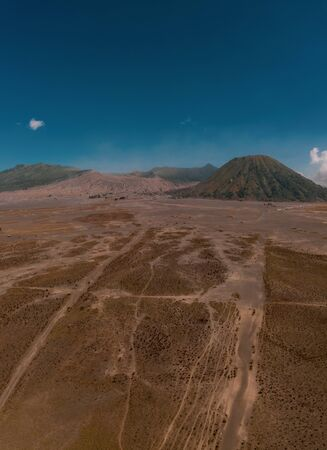 Cinematic shot view of beautiful Mount Bromo volcano with desert in East Java, Indonesia