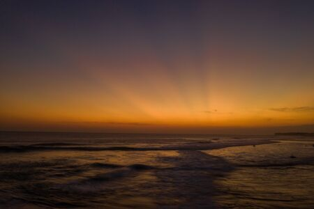 Aerial drone view of the sea over beautiful golden sunset sky background Фото со стока