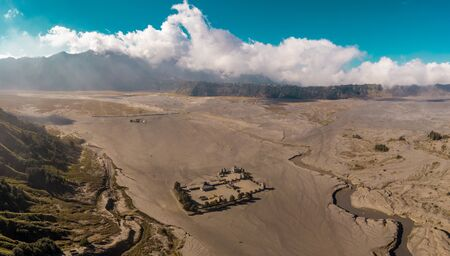 Cinematic shot aerial view of Pura Luhur Poten hindu temple near Mount Bromo volcano in East Java, Indonesia Фото со стока