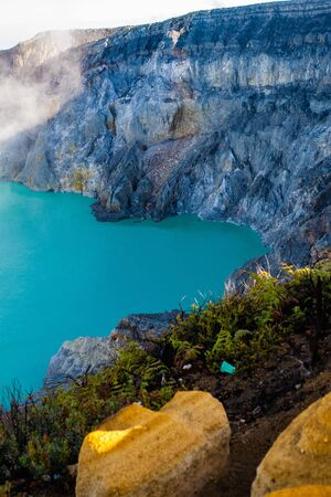 Aerial view of beautiful Ijen volcano with acid lake and sulfur gas going from crater, Indonesia Фото со стока
