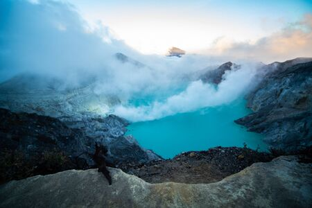 Aerial view of beautiful Ijen volcano with acid lake and sulfur gas going from crater, Indonesia Imagens