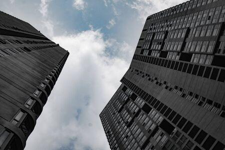 Bottom view of modern skyscrapers over cloudy sky in Kuala Lumpur, Malaysia Фото со стока
