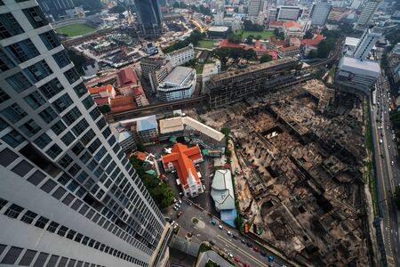 Aerial drone view of Kuala Lumpur city traffic and buildings, Malaysia