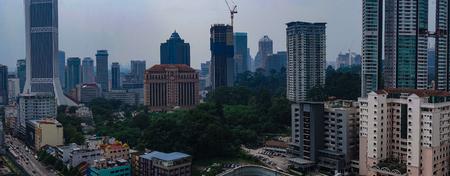 Aerial panorama of Kuala Lumpur city skyline during cloudy day, Malaysia