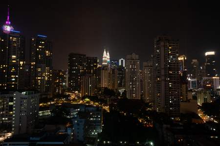 Aerial drone view of Kuala Lumpur city skyline at night, Malaysia