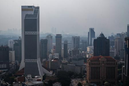 Aerial drone top view of Kuala Lumpur city traffic and buildings, Malaysia Редакционное