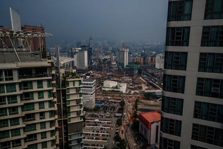 Aerial view of Kuala Lumpur city skyline during cloudy day, Malaysia Редакционное