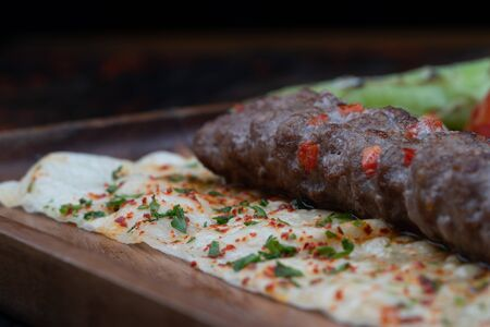 Closeup of Turkish lula lamb or beef kebab isolated on rustic wooden table  Zdjęcie Seryjne