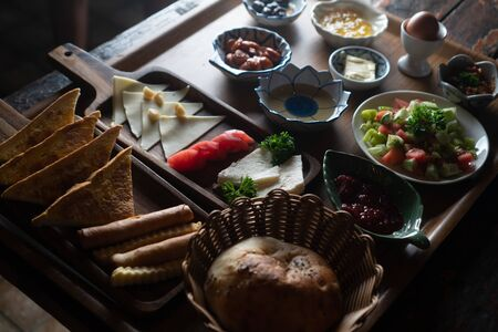 Top view of Turkish breakfast isolated on rustic wooden table