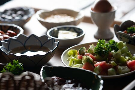 Side view of Turkish breakfast isolated on rustic wooden table Zdjęcie Seryjne