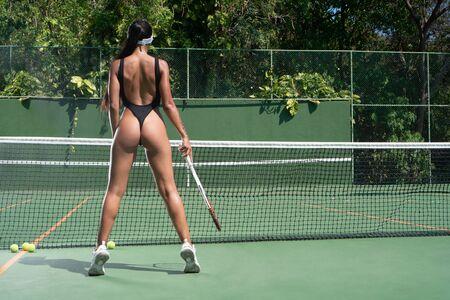girl in bikini playing tennis on the court Zdjęcie Seryjne