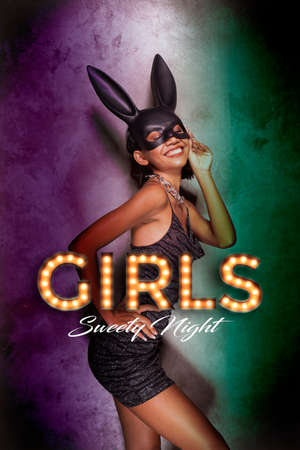 Portrait of beautiful smiling Asian woman in black dress and rabbit mask playfully posing in colorful spotlight. Sexy disco woman, girls sweety night party banner concept