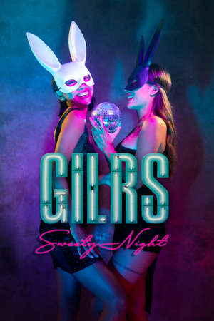 Portrait of two young cute Asian women in black and white rabbit mask posing for camera with small disco ball on the neon lights. Sexy disco women, girls sweety night party banner concept