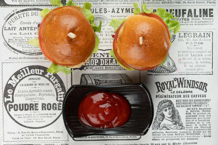 Two mini beef burgers with beetroot relish. Beef patties on two brioche buns with lettuce and beetroot