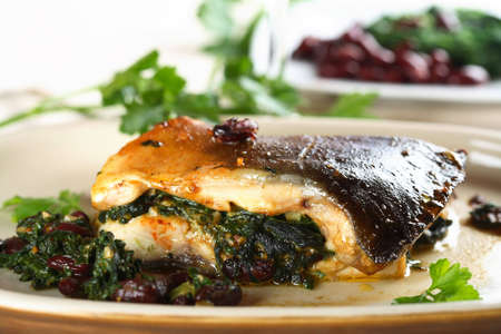 stewed: Stewed carp with spinach on the plate Stock Photo
