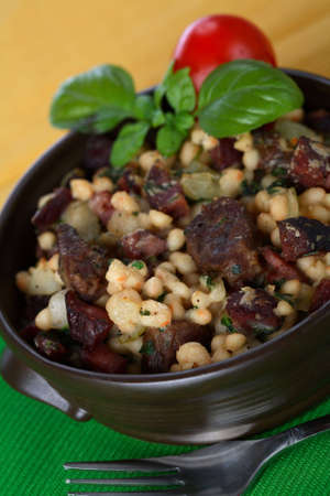 european cuisine: Casserole made from beans with sausage Stock Photo