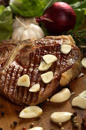 european cuisine: Steak with garlic Stock Photo