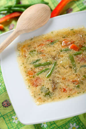 arranged: Vegetables soup on the white plate