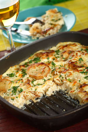 Casserole with potatoes and rice photo