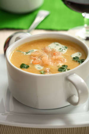 Creamy fish soup with herbs photo