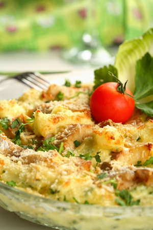 Casserole with fish and potatoes photo
