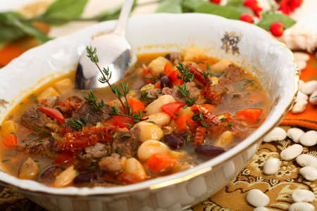 arranged: Beans soup with beef Stock Photo