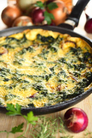 Casserole with spinach and onion photo