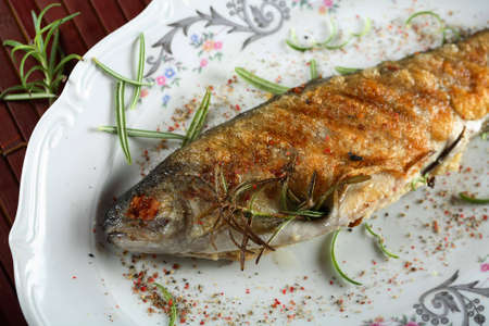 Stuffed grilled trout photo