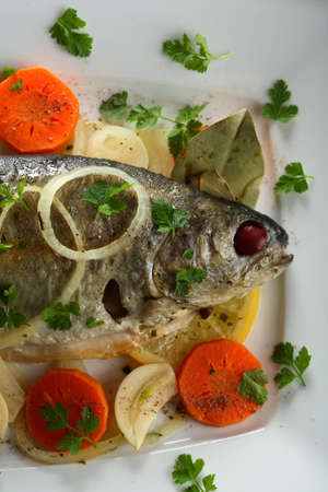 Trout with carrot and other vegetables photo