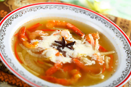 Fish bouillon with vegetables photo