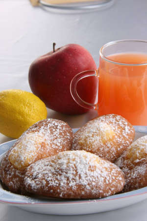 Donuts with powered sugar, juice and fruits photo