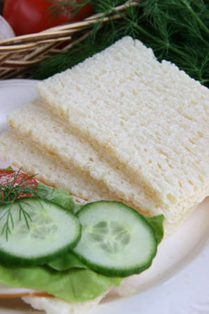 dietetic: Dietetic bread with cucumber and green lettuce