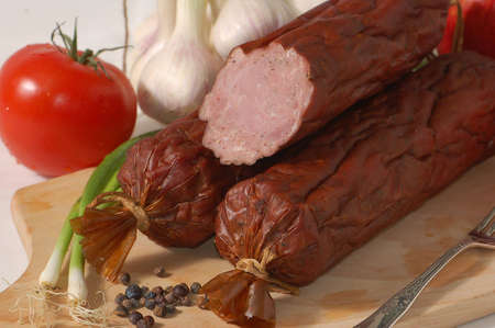 alimentary: Baked sausage on the chopping board