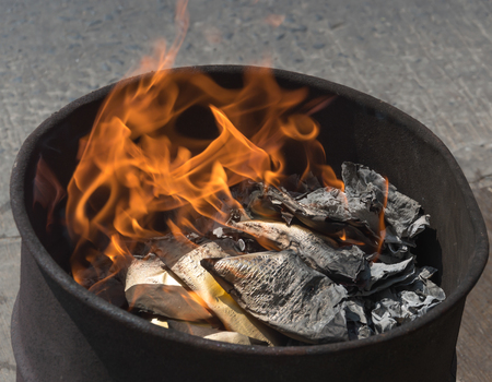Ashes of burning paper to the ancestor to pay respect and celebrate Chinese New Year Stock Photo