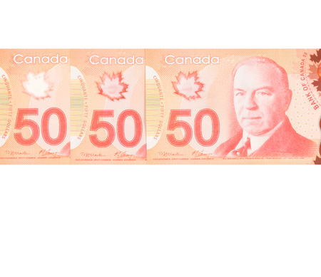 50 dollar bill: fifty Canadian dollars.Foreign currency over white background