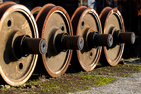 old rusty wheels of a train, locomotives wheels photo