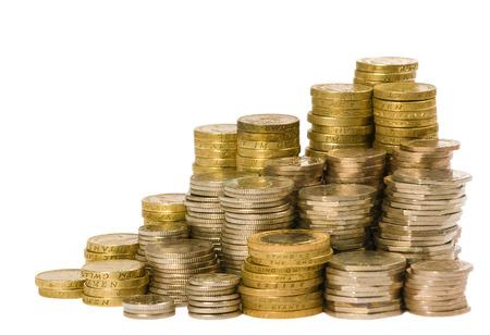 libra esterlina: Monedas británicas dispuestas sobre un fondo blanco Foto de archivo