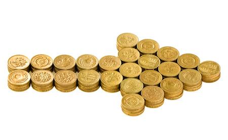 Arrow of British coins on white background Standard-Bild