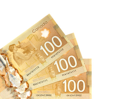 one hundred canadian dollars.Foreign currency over white background
