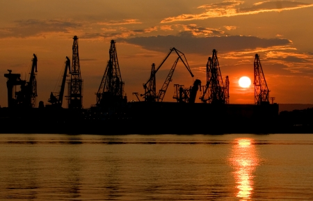 Sunset over an industry harbor with cranes in Varna,Bulgaria